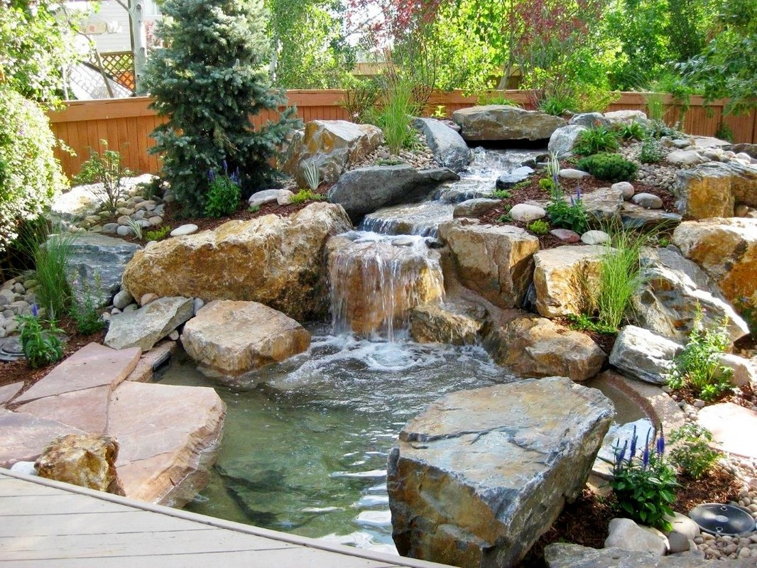Custom designed waterfalls ponds fountains new for Pond features and fountains